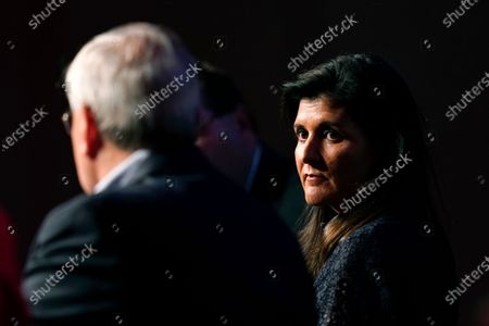 Former Ambassador to the United Nations Nikki Haley listens to former U.S. Ambassador to China Terry Branstad, left, speak during the Iowa Republican Party's Lincoln Dinner, in West Des Moines, Iowa