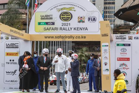 Kenya's President Uhuru Kenyatta (C) and FIA (Fédération Internationale de l'Automobile) president Jean Todt (R) tries helmets from FIA safe and affordable helmet programme launch, during the official flag off ceremony of the 2021 World Rally Championship (WRC) safari rally at KICC grounds. President Uhuru Kenyatta flagged off the 2021 World Rally Championship (WRC) Safari Rally at the Kenyatta International Convention Center in Nairobi, Kenya. Kenya Safari Rally makes a comeback after 19years and this year the Championship has attracted 58 entrants from across the world.  After the flag off from the KICC, the cars headed to Kasarani for a spectator race to showcase their skills to the public. On Friday June 25, 2021 the main race will kick off from the main Service Park at the KWS Training Institute in Naivasha along the Nairobi-Nakuru highway in Kenya.