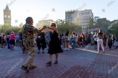 John Lopes (L) and Laurie Mokosas (R) dance in Copley Square during the Donna Summer Disco Party in Boston, Massachusetts, USA, 24 June 2021. Summer, who was born in the Dorchester neighborhood of Boston, is celebrated each year as one of the greatest Boston musicians of all time, having won five Grammys and selling millions of records during her decades-long career.