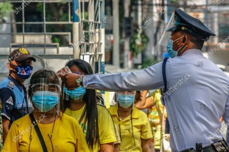 """Stock Photo of Supporters of Former President of the Philippines Benigno """"Noynoy"""" Aquino III are waiting in line to pay their respect to his ashes brought in Ateneo De Manila University in Quezon City, Philippines on June 25, 2021. Former President Benigno Aquino III publicly known as PNoy, peacefully died last Thursday morning, June 24, 2021 at the age of 61 because of Renal Disease."""
