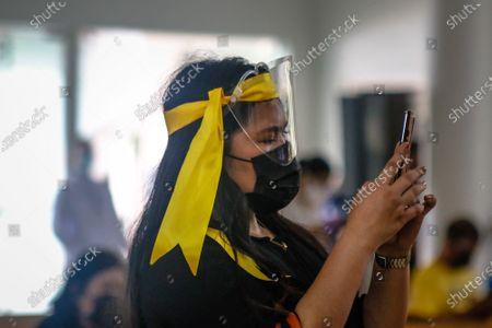 """Supporters of Former President of the Philippines Benigno """"Noynoy"""" Aquino III are waiting in line to pay their respect to his ashes brought in Ateneo De Manila University in Quezon City, Philippines on June 25, 2021. Former President Benigno Aquino III publicly known as PNoy, peacefully died last Thursday morning, June 24, 2021 at the age of 61 because of Renal Disease."""