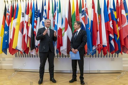 Secretary-General of the Organization for Economic Cooperation and Development (OECD) Mathias Cormann, of Australia, left, accompanied by US Secretary of State Antony Blinken, speaks at the OECD headquarters in Paris, . Blinken is on a week long trip in Europe traveling to Germany, France and Italy