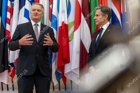 Secretary-General of the Organisation for Economic Cooperation and Development (OECD) Mathias Cormann, of Australia, accompanied by US Secretary of State Antony Blinken, right, speaks at the OECD headquarters in Paris, . Blinken is on a week long trip in Europe traveling to Germany, France and Italy