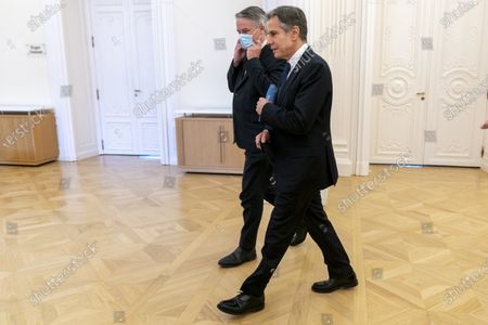 Secretary of State Antony Blinken, right, and accompanied by Secretary-General of the Organization for Economic Cooperation and Development (OECD) Mathias Cormann, of Australia, left, meet at the OECD headquarters in Paris, . Blinken is on a week long trip in Europe traveling to Germany, France and Italy