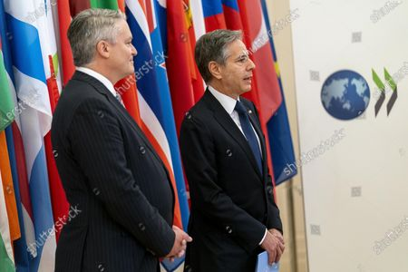 Secretary of State Antony Blinken, right, accompanied by Secretary-General of the Organization for Economic Cooperation and Development (OECD) Mathias Cormann, of Australia, speaks at the OECD headquarters in Paris, . Blinken is on a week long trip in Europe traveling to Germany, France and Italy