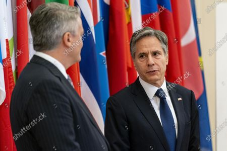 Secretary of State Antony Blinken, accompanied by Secretary-General of the Organization for Economic Cooperation and Development (OECD) Mathias Cormann, of Australia, left, speaks at the OECD headquarters in Paris, . Blinken is on a week long trip in Europe traveling to Germany, France and Italy