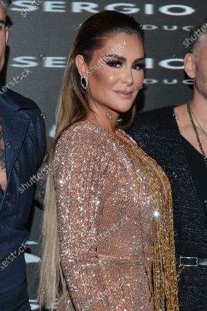 Stock Picture of Singer Ninel Conde poses for photos during the black carpet of the musical Siete at Pepsi Center on June 24, 2021 in Mexico City, Mexico.