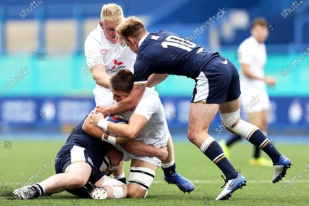 England vs Scotland. England's Harry Taylor is tackled by Patrick Harrison and Christian Townsend of Scotland