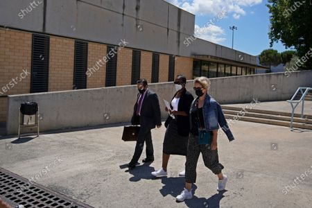 """Lawyer Javier Villalba, left and John McAfee's wife Janice, centre, enter the Brians 2 penitentiary center with an unidentified woman in Sant Esteve Sesrovires, near Barcelona, northeast Spain, . A judge in northeastern Spain has ordered an autopsy for John McAfee, creator of the McAfee antivirus software, a gun-loving antivirus pioneer, cryptocurrency promoter and occasional politician who died in a cell pending extradition to the United States for allegedly evading millions in unpaid taxes. McAfee's Spanish lawyer, Javier Villalba, said the entrepreneur's death had come as a surprise to his wife and other relatives, since McAfee """"had not said goodbye"""