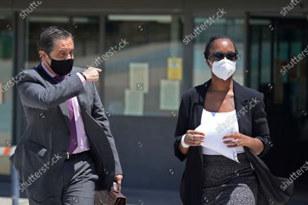 """Stock Picture of Lawyer Javier Villalba, left and John McAfee's wife Janice leave the Brians 2 penitentiary center in Sant Esteve Sesrovires, near Barcelona, northeast Spain, . A judge in northeastern Spain has ordered an autopsy for John McAfee, creator of the McAfee antivirus software, a gun-loving antivirus pioneer, cryptocurrency promoter and occasional politician who died in a cell pending extradition to the United States for allegedly evading millions in unpaid taxes. McAfee's Spanish lawyer, Javier Villalba, said the entrepreneur's death had come as a surprise to his wife and other relatives, since McAfee """"had not said goodbye"""