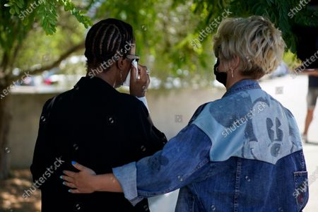 """John McAfee's wife Janice, left is consoled by an unidentified woman on leaving the Brians 2 penitentiary center in Sant Esteve Sesrovires, near Barcelona, northeast Spain, . A judge in northeastern Spain has ordered an autopsy for John McAfee, creator of the McAfee antivirus software, a gun-loving antivirus pioneer, cryptocurrency promoter and occasional politician who died in a cell pending extradition to the United States for allegedly evading millions in unpaid taxes. McAfee's Spanish lawyer, Javier Villalba, said the entrepreneur's death had come as a surprise to his wife and other relatives, since McAfee """"had not said goodbye"""