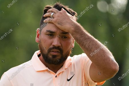 Jason Day reacts after sinking his final putt overall on the ninth green during the second round of the Travelers Championship golf tournament at TPC River Highlands, in Cromwell, Conn
