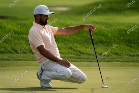 Jason Day lines up his shot on the ninth green during the second round of the Travelers Championship golf tournament at TPC River Highlands, in Cromwell, Conn