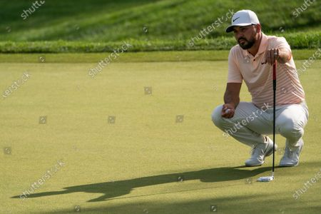Jason Day lines up his shot on the eighth green during the second round of the Travelers Championship golf tournament at TPC River Highlands, in Cromwell, Conn