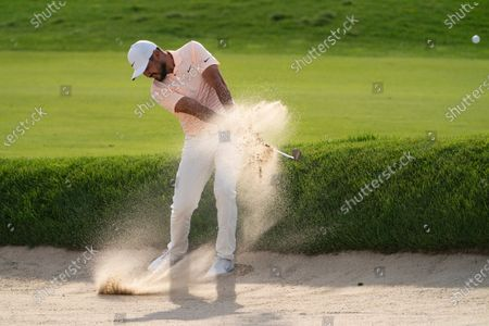 Jason Day hits from a bunker on the ninth fairway during the second round of the Travelers Championship golf tournament at TPC River Highlands, in Cromwell, Conn