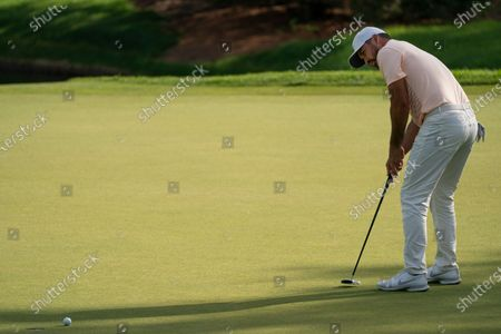 Jason Day lines sinks a putt on the eighth green during the second round of the Travelers Championship golf tournament at TPC River Highlands, in Cromwell, Conn