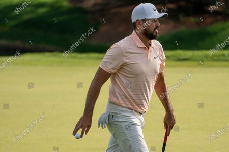 Jason Day walks off the eighth green after sinking a putt during the second round of the Travelers Championship golf tournament at TPC River Highlands, in Cromwell, Conn
