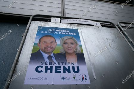 Electoral campaign boards for northern France region with local candidate Steeve Briois and Marine Le Pen, French far- right leader, in Henin-Beaumont, northern France, . Marine Le Pen's far right party is riding high on her tough-on-security, stop-immigration message as French voters start choosing regional leaders Sunday in an election that's seen as a dress rehearsal for next year's presidential vote. AP Photo/Michel Spingler