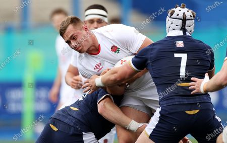 Harvey Kindell-Beaton of England is tackled by Patrick Harrison and Ollie Leatherbarrow of Scotland.