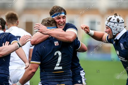 England vs Scotland. Scotland's Ben Muncaster celebrates with Patrick Harrison