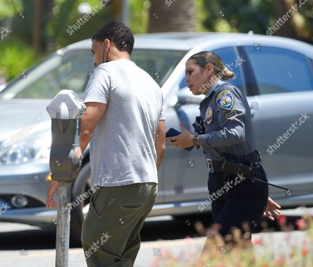 Stock Photo of Exclusive - Actor Michael Ealy looks unamused as he receives a parking ticket in Beverly Hills