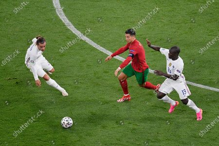Cristiano Ronaldo of Portugal battles for possession with N'Golo Kante and Anoine Griezmann of France during the UEFA European Championship 2020 football match between Portugal and France at Stadium Puskas Ferenc on June 23, 2021 in Budapest, Hungary.
