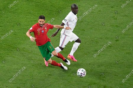Joao Moutinho of Portugal battles for possession with N'Golo Kante of France during the UEFA European Championship 2020 football match between Portugal and France at Stadium Puskas Ferenc on June 23, 2021 in Budapest, Hungary.