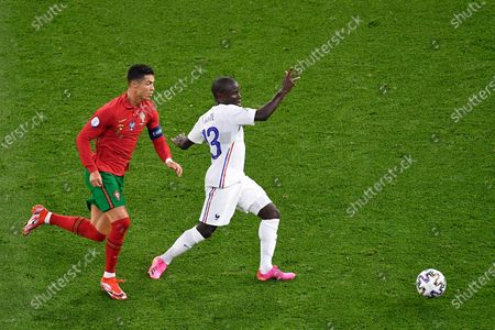 Cristiano Ronaldo of Portugal battles for possession with N'Golo Kante of France during the UEFA European Championship 2020 football match between Portugal and France at Stadium Puskas Ferenc on June 23, 2021 in Budapest, Hungary.