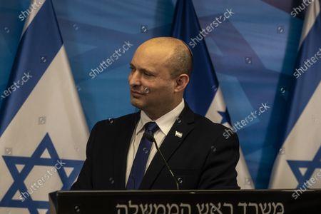 Stock Image of Israeli Prime Minister Naftali Bennett listens to Honduran President Juan Orlando Hernandez (unseen), during their statements at the Prime Minister's Office