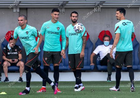 Stock Picture of Pepe, Cristiano Ronaldo, Sergio Oliveira and Jose Fonte (L-R) of Portugal participate in a training session for the UEFA Euro 2020 soccer tournament in Illovszky Rudolf Stadium in Budapest, Hungary, 25 June 2021. Portugal will play against Belgium in the round of 16 in Sevilla on 27 June.