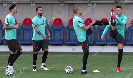Jose Fonte, Sergio Oliveira, Pepe and Cristiano Ronaldo (L-R) of Portugal participate in a training session for the UEFA Euro 2020 soccer tournament in Illovszky Rudolf Stadium in Budapest, Hungary, 25 June 2021. Portugal will play against Belgium in the round of 16 in Sevilla on 27 June.