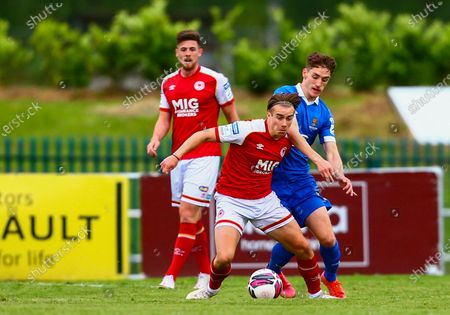 Waterford vs St. Patrick's Athletic. St Pat's Matty Smith with Waterford's John Martin