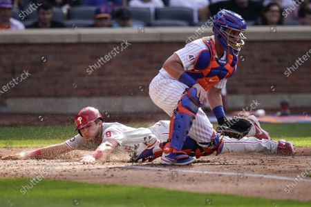 Stock Picture of Philadelphia Phillies' Nick Maton, left, slides past New York Mets catcher James McCann to score on a double by Aaron Nola during the fifth inning of the first baseball game of a doubleheader, in New York