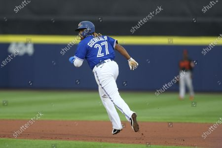 Toronto Blue Jays' Vladimir Guerrero Jr. advances to second base on a wild pitch by Baltimore Orioles starter Matt Harvey during the first inning of the baseball game in Buffalo, N.Y
