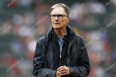Boston Red Sox owner John Henry walks on the field before a baseball game against the New York Yankees, in Boston