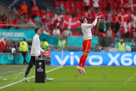Gareth Bale of Wales leads the team out onto the pitch