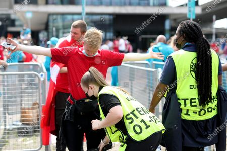 Stock Image of Denmark fans are searched by security as they arrive at the stadium