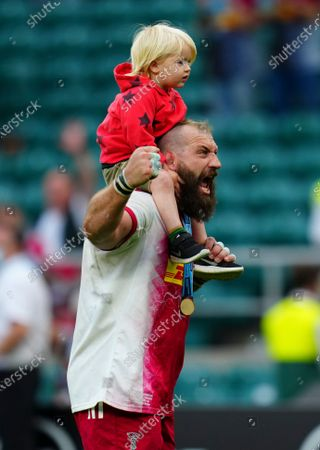 Joe Marler of Harlequins celebrates with one of his children on his shoulders