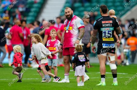 Stock Photo of Joe Marler of Harlequins and Jack Nowell of Exeter Chiefs on the pitch with their children at full time