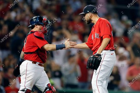 Boston Red Sox's Matt Barnes, right, celebrates with Christian Vazquez after defeating the New York Yankees in a baseball game, in Boston