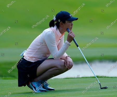 Michelle Wie West lines up her putt on the second hole during the second round of play in the KPMG Women's PGA Championship golf tournament, in Johns Creek, Ga