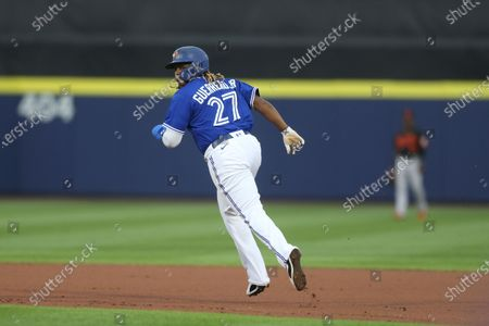 Toronto Blue Jays' Vladimir Guerrero Jr. advances to second base on a wild pitch by Baltimore Orioles starting pitcher Matt Harvey during the first inning of the baseball game in Buffalo, N.Y
