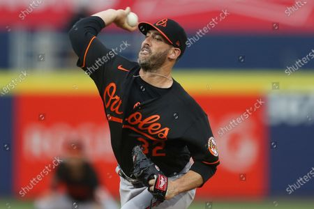 Baltimore Orioles starting pitcher Matt Harvey (32) throws a pitch during the first inning of a baseball game against the Toronto Blue Jays in Buffalo, N.Y