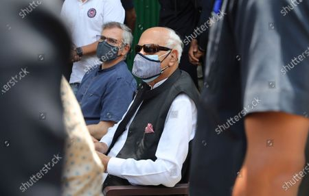 Member of Indian Parliament and President of National Conference (NC) Farooq Abdullah (R) and his son NC vice-president and the former Jammu and Kashmir chief minister Omar Abdullah (L) speak to the media in Srinagar, the summer capital of Indian Kashmir, India, 26 June 2021, fter their return from Delhi, where they attended the All Party Meeting on J&K convened by Indian Prime Minister Narendra Modi on June 24.