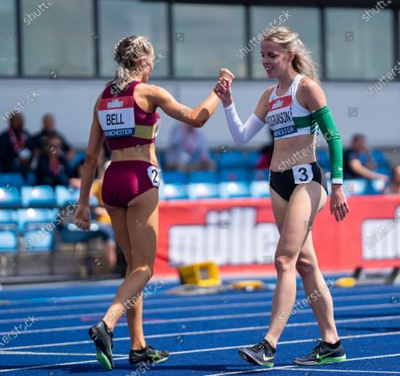 Stock Image of Alex Bell and Keely Hodgkinson congratulate each other as they are both into the women's 800m finals; Manchester Regional Arena, Manchester, Lancashire, England; Muller British Athletics Championships.