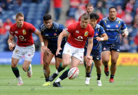 Owen Farrell - British & Irish Lions replacement centre chases after a loose ball with Liam Williams (far left).