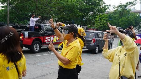 People waving yellow ribbons and holding the Philippine flag while the funeral motorcade of former Pres. Noynoy Aquino passing thru C5 in Quezon City.