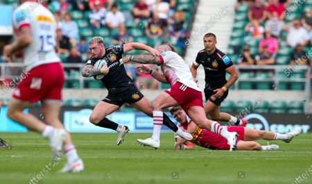 Stuart Hogg of Exeter tackled by Joe Marler of Harlequins