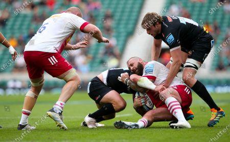 Joe Marler of Harlequins is tackled