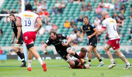 Jonny Gray of Exeter tackled by Luke Northmore of Harlequins